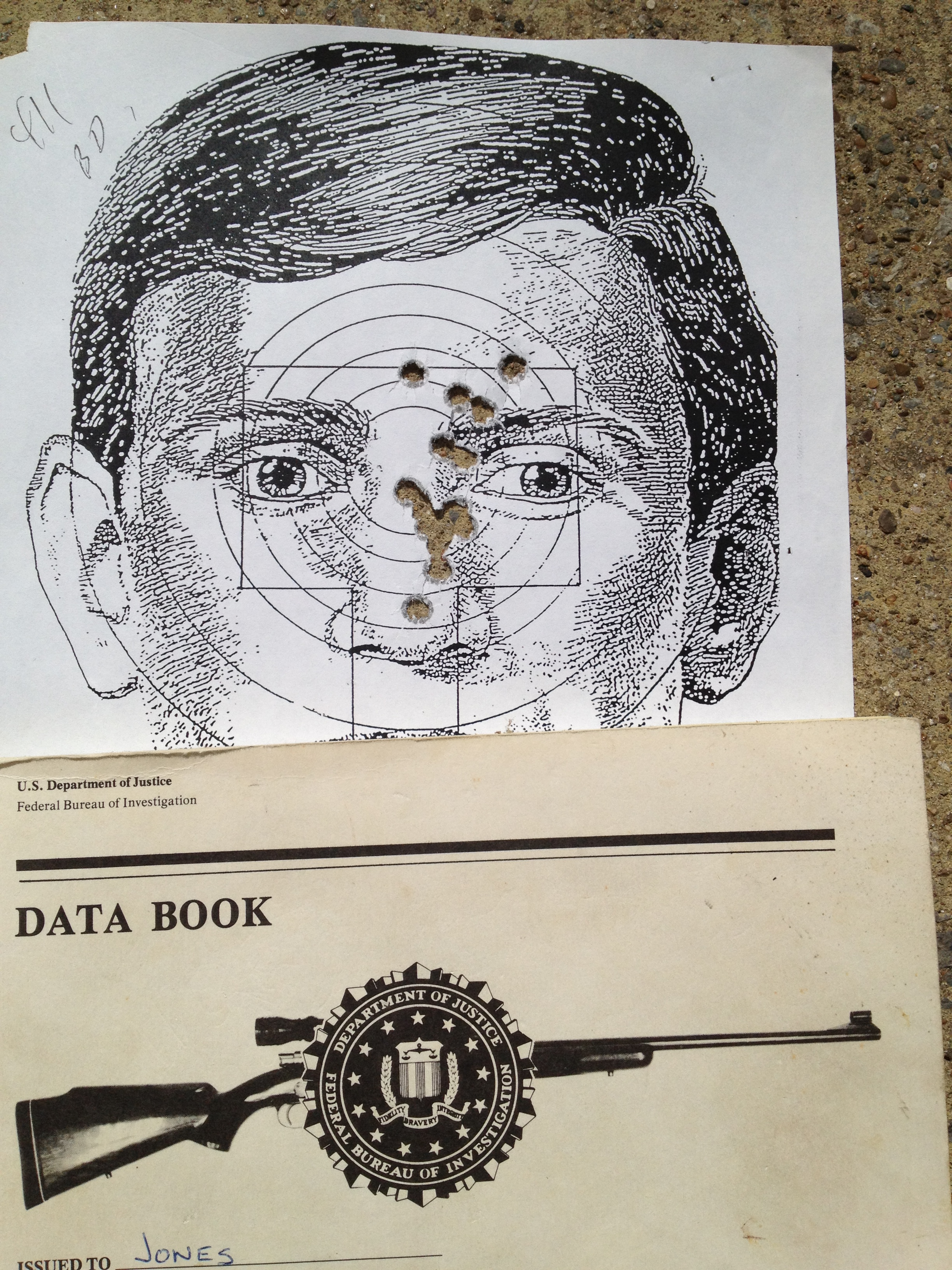 An old qualification target with a vintage FBI sniper school data book.  Documentation on the target states that the run was made in 4:11 total.