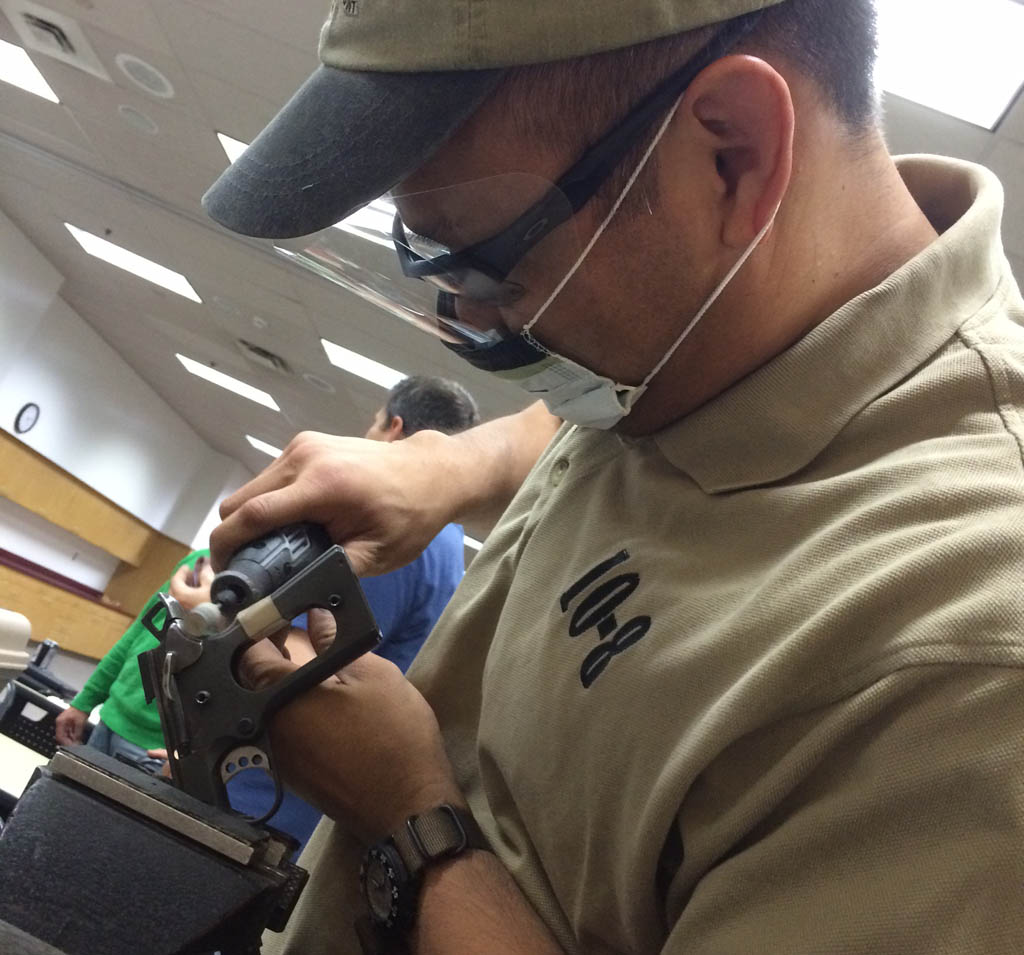 Here I am blending a grip safety for a student. This is normally far beyond the scope of the class, but this student has been carrying this pistol on duty and I couldn't bear to see the frame cutting into his hand any longer.